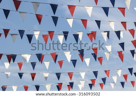 Red white and blue triangular bunting - stock photo