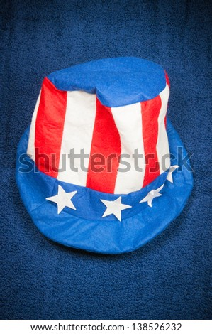 Red, white and blue Uncle Sam's hat symbolizing the United States of America and the fourth of July celebration - stock photo