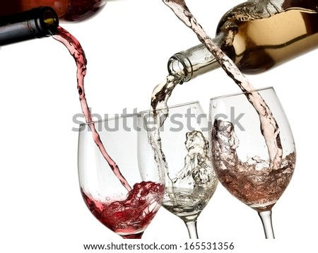 Red, white and rose wine pouring  - stock photo