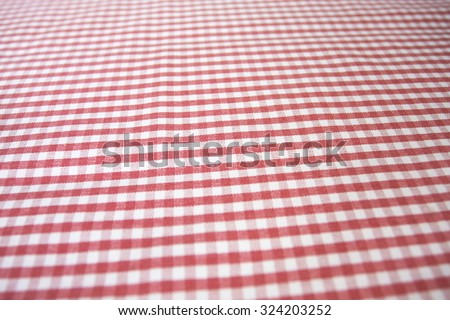 red white checkered table cloth - stock photo