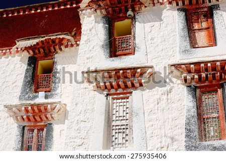 Red windows-Potala palace with the Potrang Karpo and Marpo-Red and White palaces to the E.and W.at 3700 ms.high on Marpo Ri-Red Hill 300 ms.over the valley. Lhasa-Tibet. - stock photo