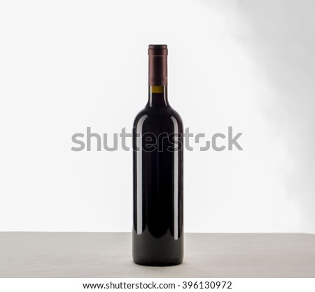 red wine and a bottle isolated over white background.  - stock photo