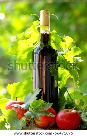 Red wine and apples. - stock photo