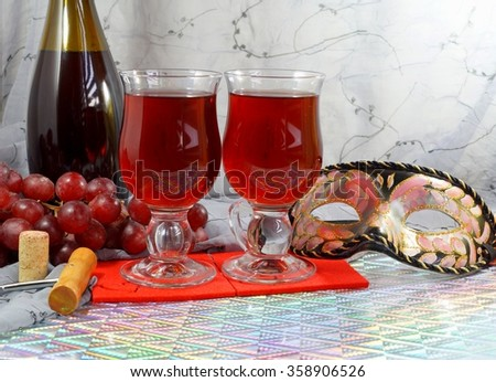 Red wine and carnival mask - carnival - selective focus - stock photo