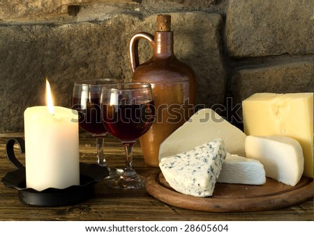 Red wine and cheese - stock photo