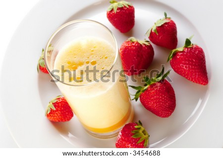Red wine and fresh egg shake with strawberries