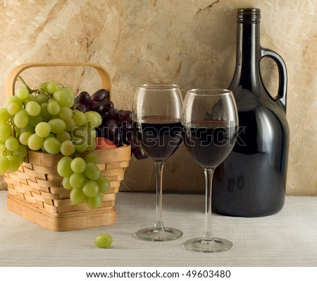 Red wine and grapes composition - stock photo