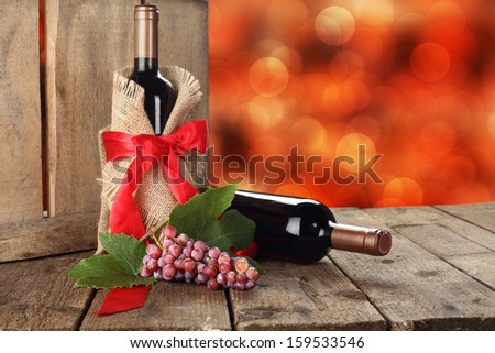 red wine and ribbon  - stock photo