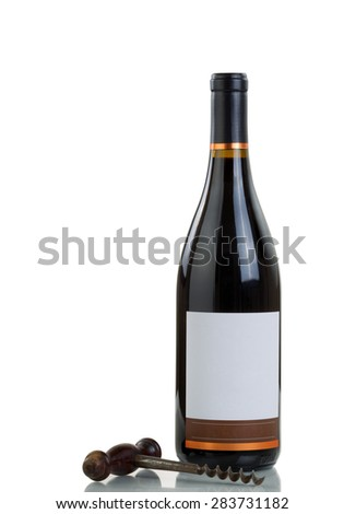 Red wine and vintage corkscrew isolated on white background with reflection.  - stock photo