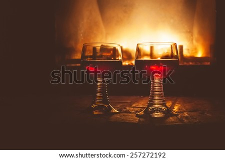 Red wine at the fireplace - stock photo