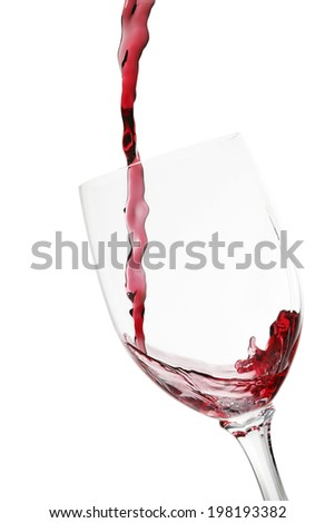 red wine being poured into glass isolated