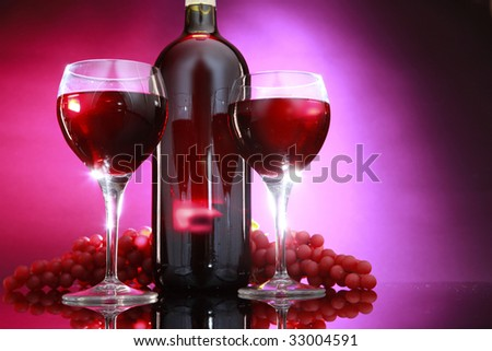 Red wine bottle and a couple of glasses