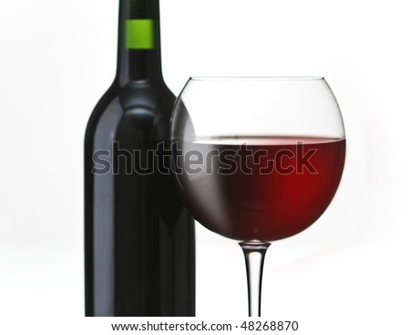 red wine bottle and glass - stock photo