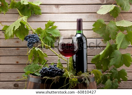 red wine bottle and glass background - stock photo