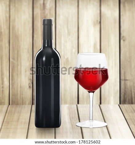 Red Wine bottle and glass on wood background  - stock photo
