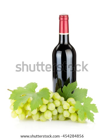 Red wine bottle and grapes. Isolated on white background - stock photo