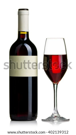 Red wine bottle and wine glass filled with the red wine isolated - stock photo