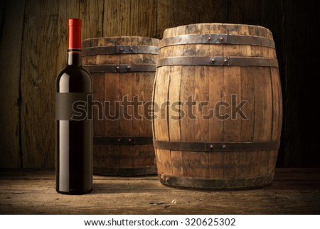 red wine bottle and wooden barrel - stock photo