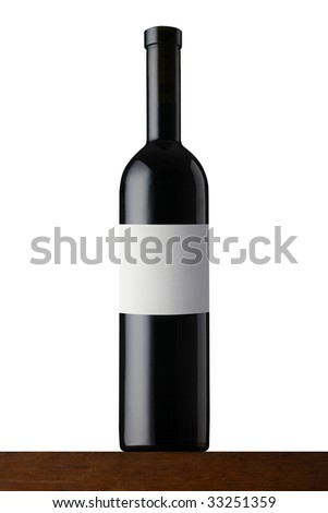 Red wine bottle on wood - stock photo