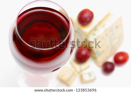 Red wine, cheese and grapes - stock photo