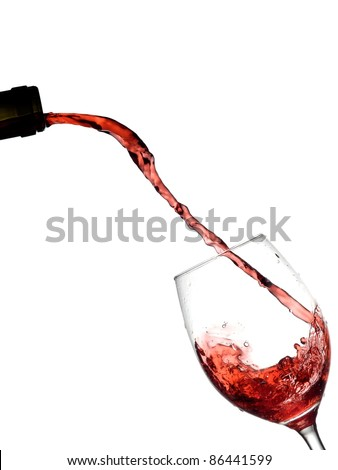Red wine flow in a glass - stock photo