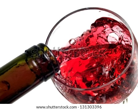 Red wine flow in a glass, top view