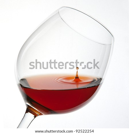 Red Wine Glas silhouette with a Drop on White Background - stock photo