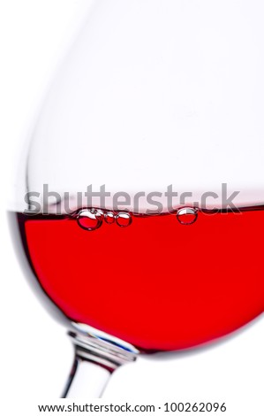 Red wine glass against the light - stock photo