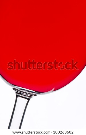 Red wine glass against the light