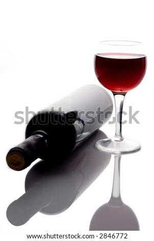 Red wine glass and wine bottle - stock photo