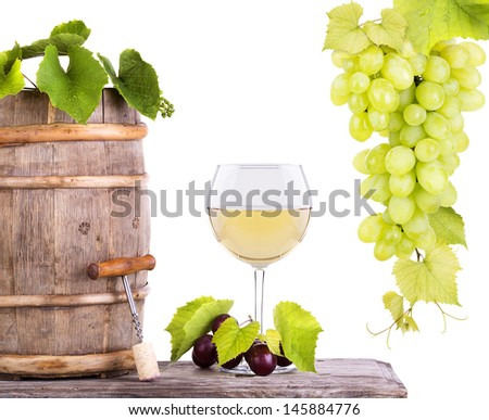 Red wine, glass barrel with grapes over white - stock photo