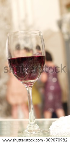 Red Wine Glass for Wine Tasting with Blur Celebration Party in Background - stock photo