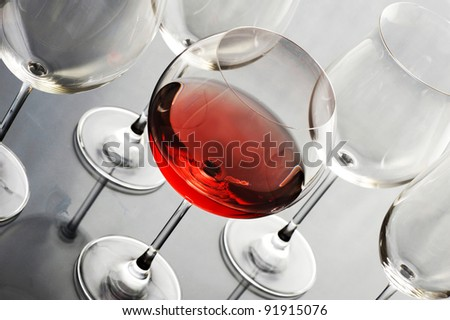 red wine glass on steel background