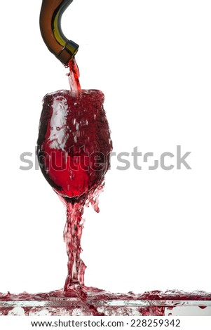 Red Wine Glass Overflowing  - stock photo