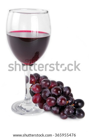 red wine glass with red grapes isolated on white - stock photo