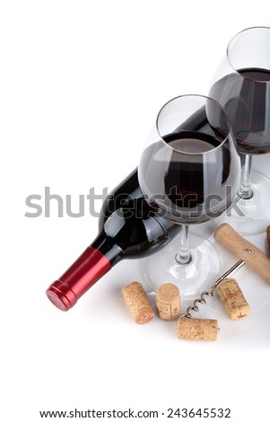 Red wine glasses, bottle and corks. Closeup. Isolated on white background - stock photo