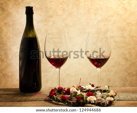 red wine glasses with romantic mood - stock photo