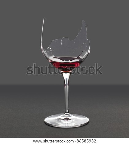 Red wine in a broken wine glass with an extraction path saved in the file