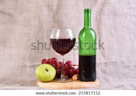 red wine in glass and bottle with grapes and apple  - stock photo