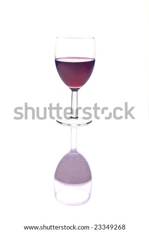 Red wine in glass with reflection