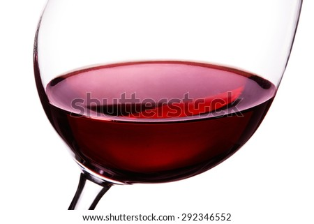 Red wine in the glass . closeup macro shot isolated on white.  - stock photo