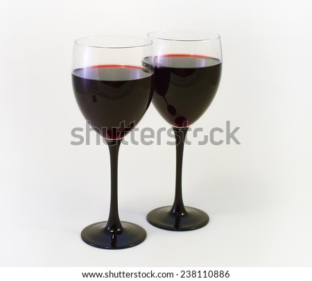 Red wine in two high wine glasses - stock photo