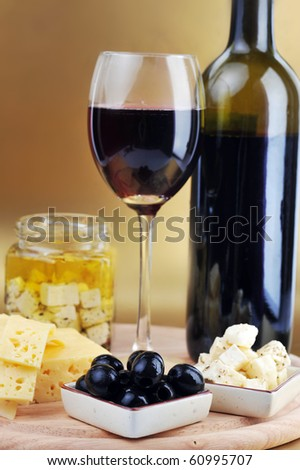 Red wine in wineglass cheese and olives