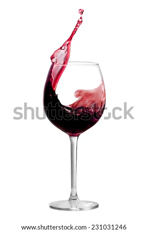 Red wine is splashing out of a wine glass - stock photo
