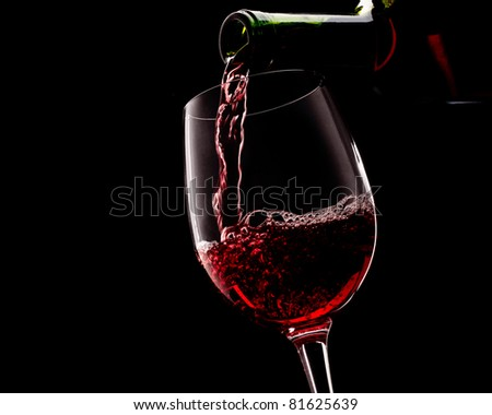 red wine on a black background - stock photo