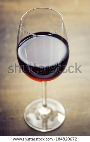 Red wine on old wooden table