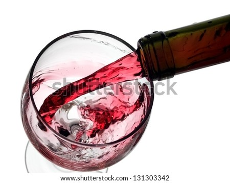 Red wine pour in a glass, above view - stock photo