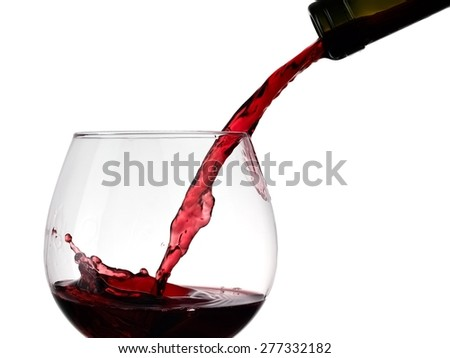 Red wine pouring, close up - stock photo