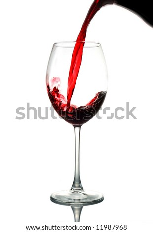 Red wine pouring down - stock photo