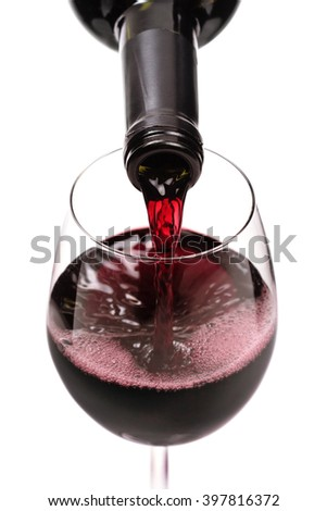 red wine pouring in a glass - stock photo
